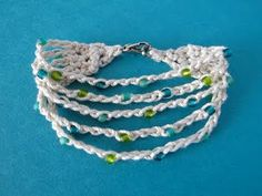 Crocheted beaded bracelet.  Click for Free pattern, but again, this is super cute for an idea.  Can't be too tough.  Size ten, beads and chain stitch.