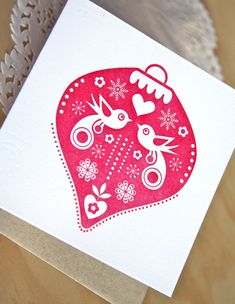 Letterpress Christmas card, Christmas bauble, Scandinavian folk style, birds, snowflakes, ruby red. Made in Australia. $5.50, via Etsy.
