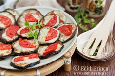 baked eggplant with mozzarella and basil.....fry the eggplant slices, then add cheese and basil, bake