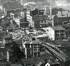 """Detail of view from Beaucatcher, circa 1912. Marjorie St. runs to the right of the old county jail. South building of current Pack's Tavern hasn't been added. Thomas Wolfe's father's monument shop (current site of Jackson bldg.) visible with ""Uneeda Biscuit"" advert on side. Vance monument clearly visible."" Shared by Vance Pollock on ""Asheville, the way it WAS"" Facebook page."