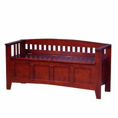 "Hardwood split-top storage bench in deep cherry. Product: Storage benchConstruction Material: HardwoodColor: Deep cherryFeatures: Split-topHinges allow bench to stay open for safetyDimensions: 25.2"" H x 50"" W x 16.88"" D"