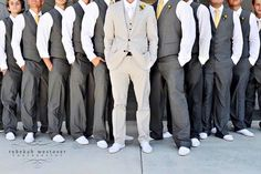 Grey suits! LOVE this look of the darker groomsmen grey suits with the grooms lighter grey suit. Very chic!