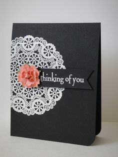 handmade card ... black cardstock base ... white embossed doily off the edge ... pop of peach from dimensional flower ... luv it!!