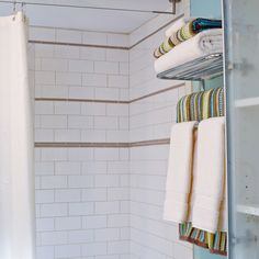 Hang convenient towel storage racks within reach of the shower. | Photo: David Lamb