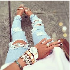 ripped jeans, stacked bracelets