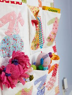 Hanging Storage. As with any other room in the house, it's important that your child's bedroom storage solutions offer both function and style. This hanging quilt was outfitted with pockets that provide storage space for plush dolls, art supplies, dress-up beads, and more. Consider repurposing a shoe organizer for over-the-door -- and off-the-floor -- organization.