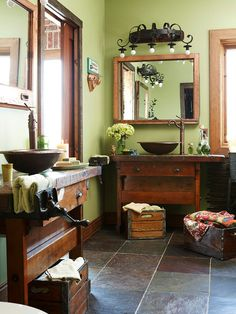 Bathroom with wood crate storage for towels and workbenches modified for vanities with sinks.