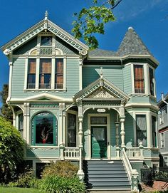 A sweet little Queen Anne Victorian in shades of green-blue and turquoise.