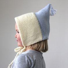 A charming color block hand knit bonnet.