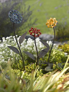 faucet crafts, flower garden art, art garden, backyard art, artful garden