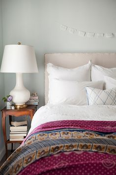 Kantha bedspread on crisp white sheets