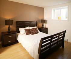 Love the brown accent wall, simple but nice for a guest room maybe