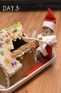 The elf gets a hold of the Gingerbread house