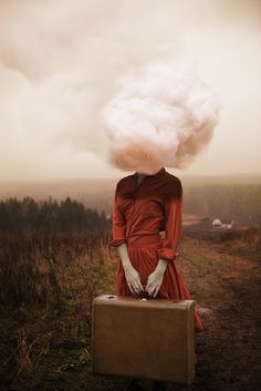 woman with head covered by cloud
