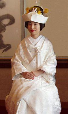 A traditional Japanese wedding kimono with tsunokakushi (wedding headpiece)