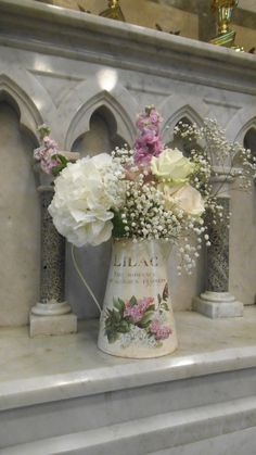 pretty jugs of flowers by Posy Barn