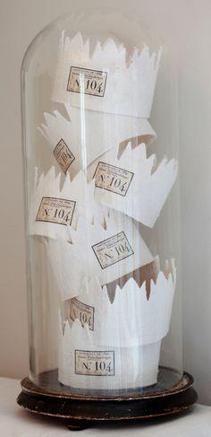 Paper Crowns Under a Cloche.