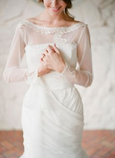 gorgeous delicate wedding gown with a boatneck sheer cover http://eventsbyclassic.com