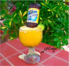 Moon-a-rita...... fresh mango margarita follow this recipe 1oz Tequila, 1/2oz triple sec,1/2oz sweet  sour mix,1/2 cup of fresh frozen mangos,blend with ice  Blue Moon beer (summer honey wheat)  1 Lime wedge