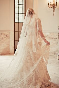 Beautiful dress by Allure bridal couture with alterations and hand made veil by the bride and MOB