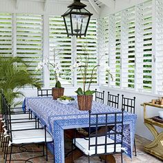 We Love ... vaulted ceilings—their lofty heights not only add architectural interest but also facilitate cooling in open-air island pavilions. Also love the shutters, latern light and the blue table cloth!!!