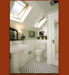In this unconventional bathroom, Donna DuFresne made good use of every nook and cranny. Medicine cabinets were clearly out of the question, given the pitch of the vaulted ceiling, so she procured a small mirror that packs a high-style punch, and built in storage over the toilet.