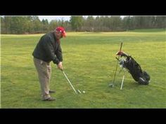 ▶ Golf Swing Tips : How to Hit Down on a Golf Ball - YouTube