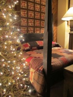 love the Christmas lights against the quilts