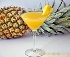 Pineapple Martini (2 Ounces Coconut Rum (I used Malibu Rum)   2 Ounces Pineapple Juice (fresh or canned)   Pineapple Wedge (optional))