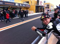 Jorge Lorenzo laughs at the scene outside of Valentino Rossi's garage during the second day of off-season testing.