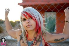 suicide girl with chest piece and lip ring