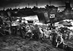 On February 19, 1945, during World War II, some 30,000 U.S. Marines began landing on Iwo Jima , where they began a successful month-long battle to seize control of the island from Japanese forces.  American supplies being landed at Iwo Jima