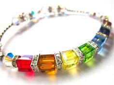 vibrant, sparkling array of Swarovski crystal cubes. Chakras!! bead, cube bracelet, bracelets, rainbows, craft idea, crystal earrings, cubes, swarovski crystals, jewelri