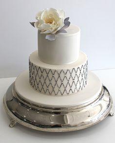 A two-tier beaded lattice #weddingcake | Brides.com