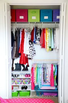 Maximising all areas of space in this child's closet- overhead fabric bins, a closet doubler and on the floor stacking shelves.