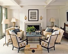 Victoria hagan caesarstone interior design symmetrical room. Symmetrical furniture layout. Two-tone wood framed chairs. English rolled arm sofa. Blue and cream color palette. Antique church pew. Granite top coffee table with iron base. Contemporary interior. Tongue and groove wood paneled walls.