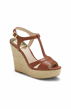 INSLO2 Vince Camuto espadrille wedge sandals brown leather gold buckle hardware $118.00 0 (No reviews) Write a Review Details A towering jute wedge supplements a simple T-strap on the Vince Camuto Inslo2. Choose...