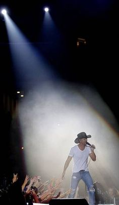 Tim McGraw performing at Cowboys Stadium in the Brothers of the Sun tour with Kenny Chesney.