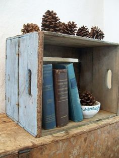 DIY a book case out of a crate. Add pinecones. Gorjuss!