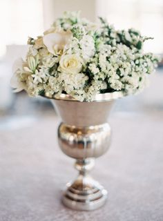 Rent silver urn vases for wedding centerpiece Photography by: http://joshgruetzmacher.com/