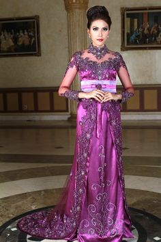 Kebaya long trail in oval shave with a good look nice a girl in fashion perfomance and also suitable for wedding dress.