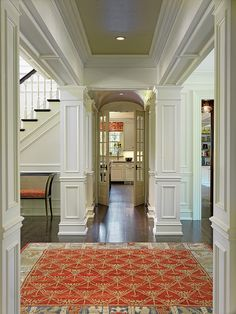 I adore the millwork in this inviting hallway!