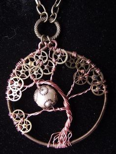 A steampunk tree of life with copper & bronze wire, jump rings, watch cogs, and an ivory glass pearl...like!