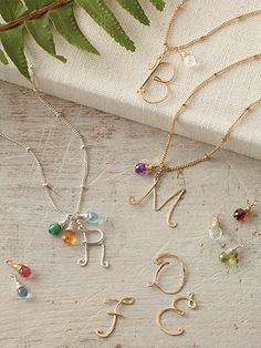 Top Quality Unique Personalized Gifts at Red Envelope via http://www.AmericasMall.com/redenvelope-gifts Birthstone + Letter Pendant Necklace, starting at $119.95, RedEnvelope I want this! #redenvelope #gifts #personalizedgifts