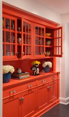 Bold coral painted built in cabinetry