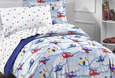 Boyish motifs in red, yellow,   and blue create a room that's both cute and mature. Try pairing colorful bedding with a solid red nightstand or dresser. Continue the color scheme with fun patterned sheets, or create a more grown-up look with solid white or dark blue linens.