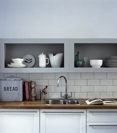 Love the splashback tiles and low level storage (no more banging cupboard doors)