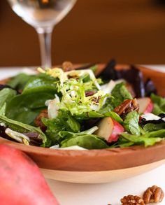 A fall salad with pears and candied pecans