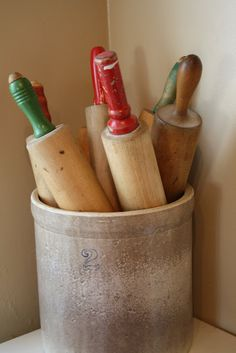 You can ever go wrong with displaying rolling pins in a crock.