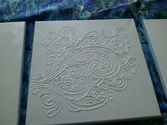 a pinned project that I actually did...canvas, white puffy paint design, white paint, set of 3